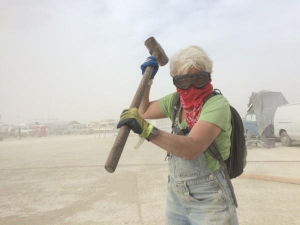 Carol hammering in rebar in the wind storm