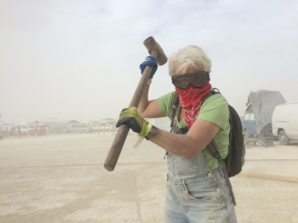 Carol hammering in rebar in the wind storm