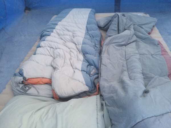 Dusty sleeping bags inside of tent
